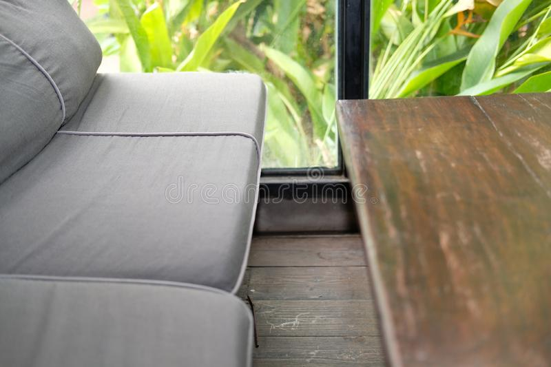 Sofa couch in living room near garden window. Blue sofa couch in living room near garden window royalty free stock image