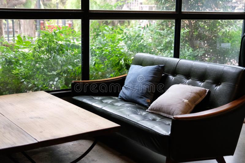 Sofa couch in living room near garden window. Leather sofa couch in living room near garden window stock photography