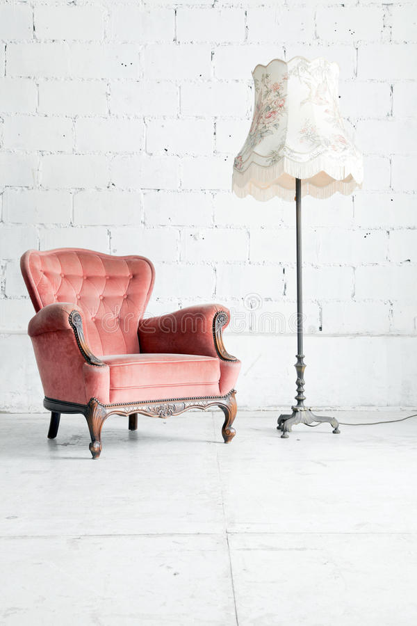 Sofa with desk lamp in vintage room royalty free stock photography