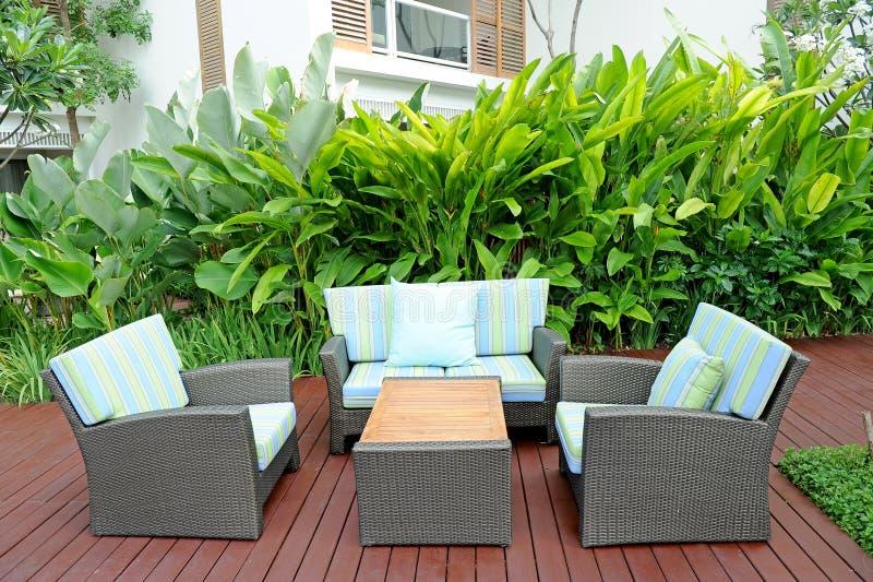 Sofa in garden stock image