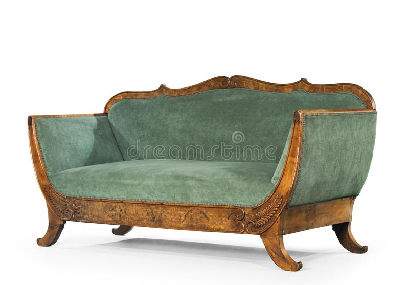 Sofa green upholstered antique retro couch isolated. Elegant beautiful sofa couch upholstered in green antique and retro isolated on white stock photo