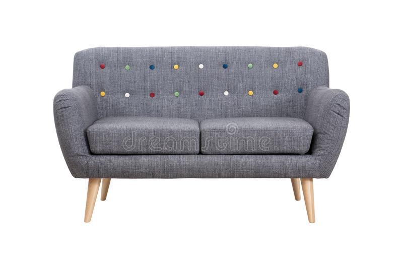 Gray sofa in Scandinavian style on wooden legs royalty free stock image