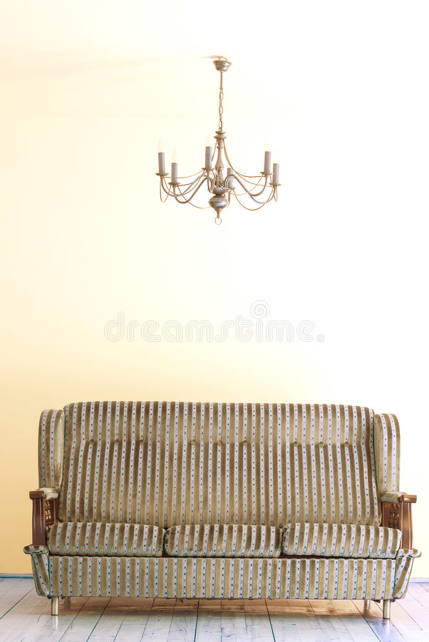 Sofa and lamp. Sofa and the lamp above it