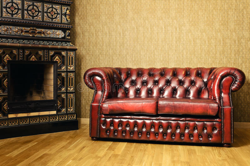 Sofa Near The Fireplace royalty free stock image