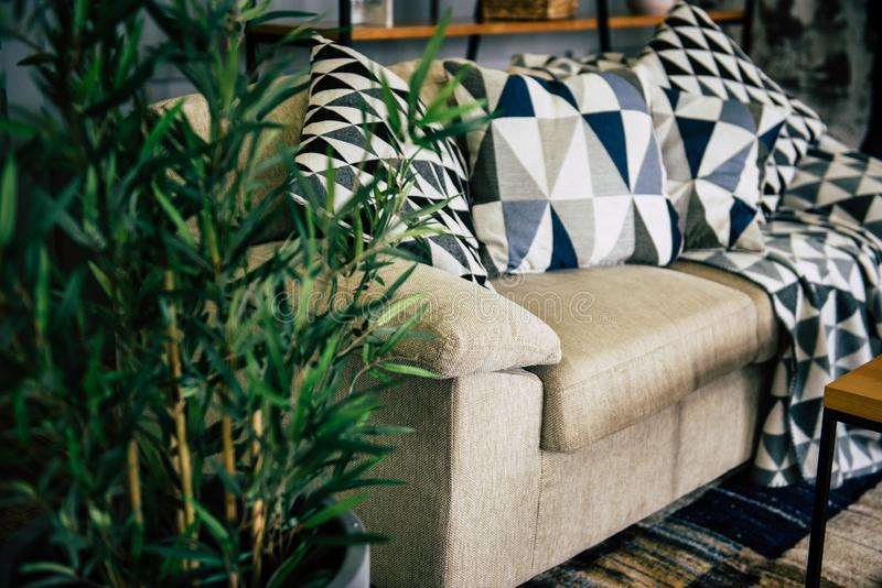Sofa with pillows stock images