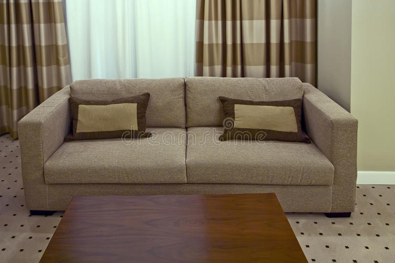 Sofa with two pillows royalty free stock photography