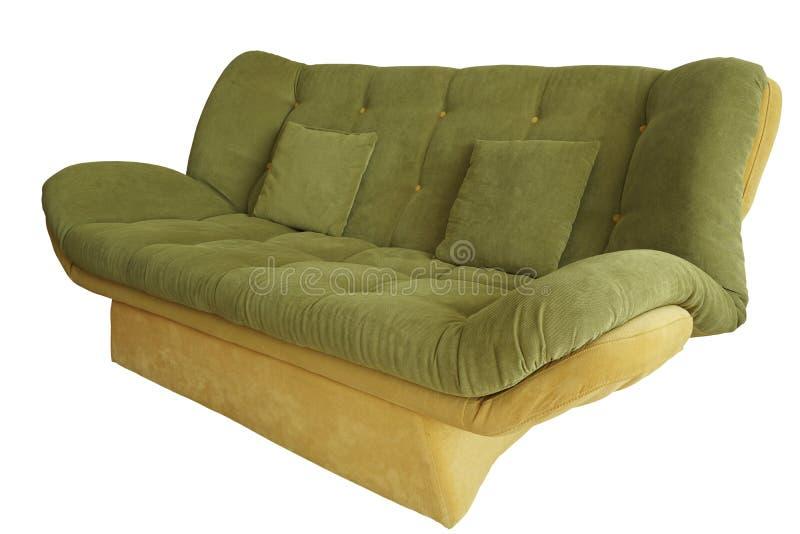 Sofa vert sous le fond blanc image libre de droits