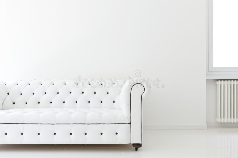 Sofa in white room. Interior, leather sofa in white room royalty free stock image