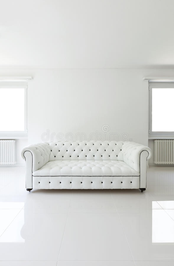 Sofa in white room. Interior, leather sofa in white room royalty free stock photos