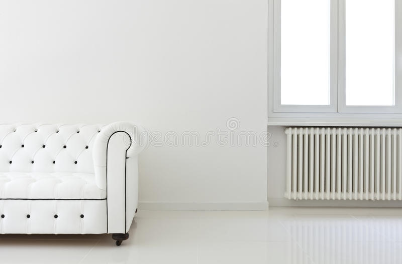 Sofa in white room, detail. Interior, leather sofa in white room, detail royalty free stock image