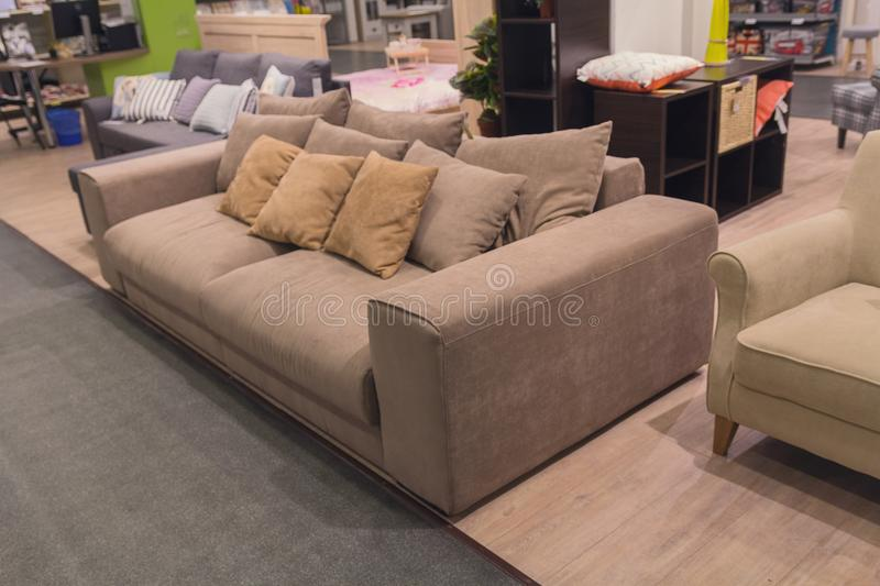 Sofas exhibited in the furniture store stock photos