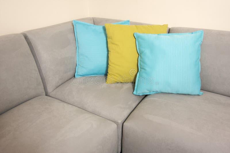 soffagrey pillows suede royaltyfri foto