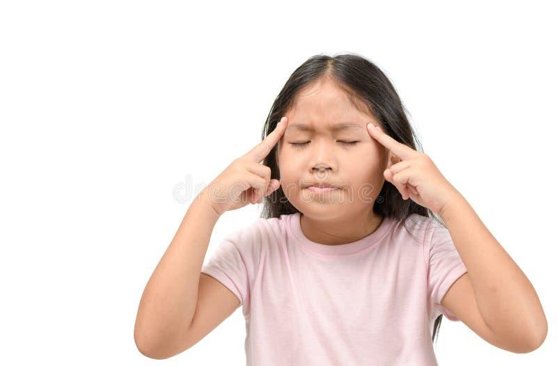 Sofferenza asiatica della bambina dall'emicrania immagine stock libera da diritti