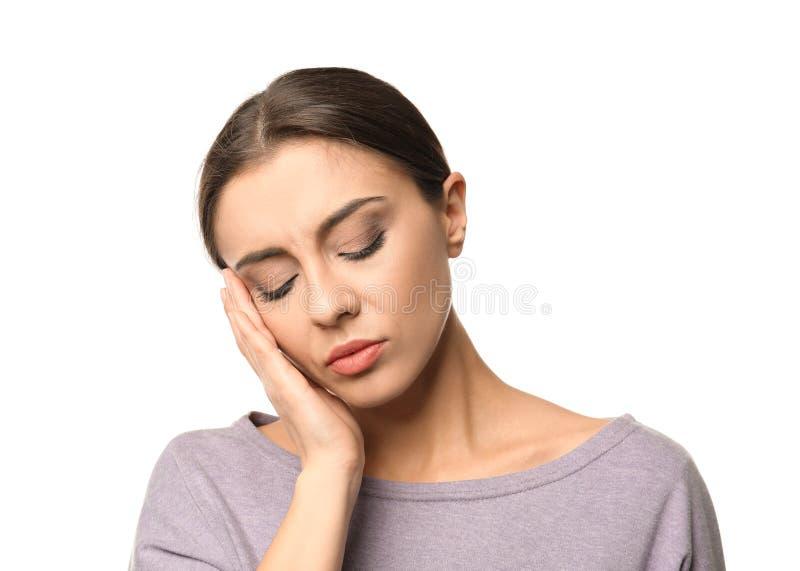 Sofferenza della donna dall'emicrania su fondo bianco immagini stock libere da diritti