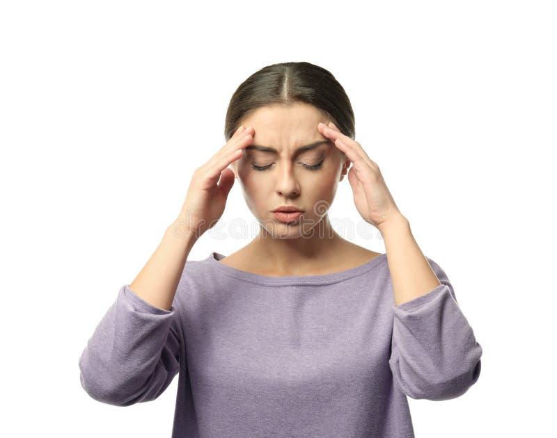 Sofferenza della donna dall'emicrania su fondo bianco fotografie stock