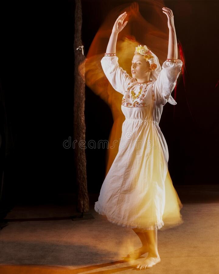 Beautiful young female Bulgarian folk dancer in national costume royalty free stock photos