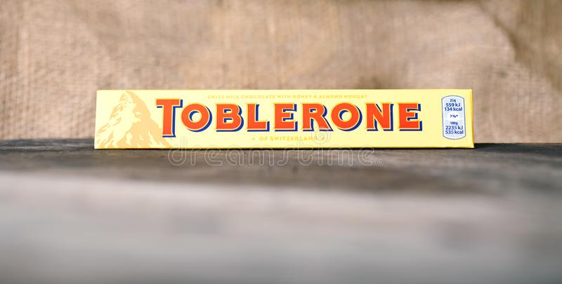 Toblerone - Swiss milk chocolate front view, selective focus, dark wooden background. SOFIA, BULGARIA - MAY 05, 2017: Toblerone - Swiss milk chocolate front view stock images