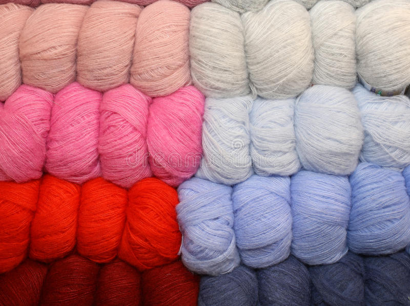 Soft balls of colored wool to create handmade sweaters. Many soft balls of colored wool to create many handmade sweaters royalty free stock image