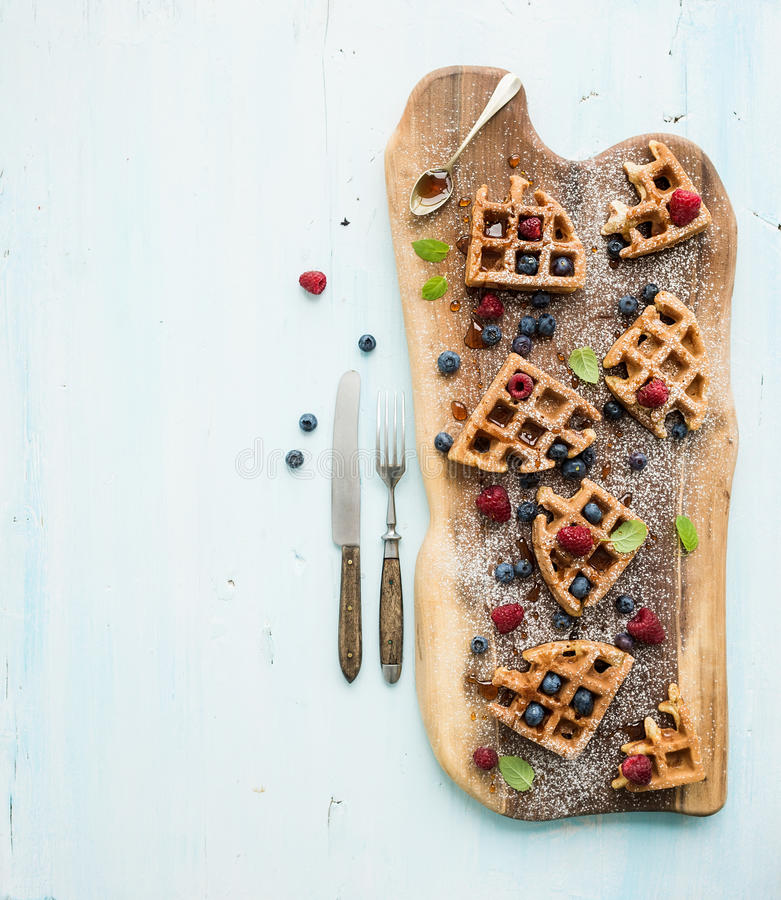 Soft Belgian waffles with berries, honey and mint stock photography