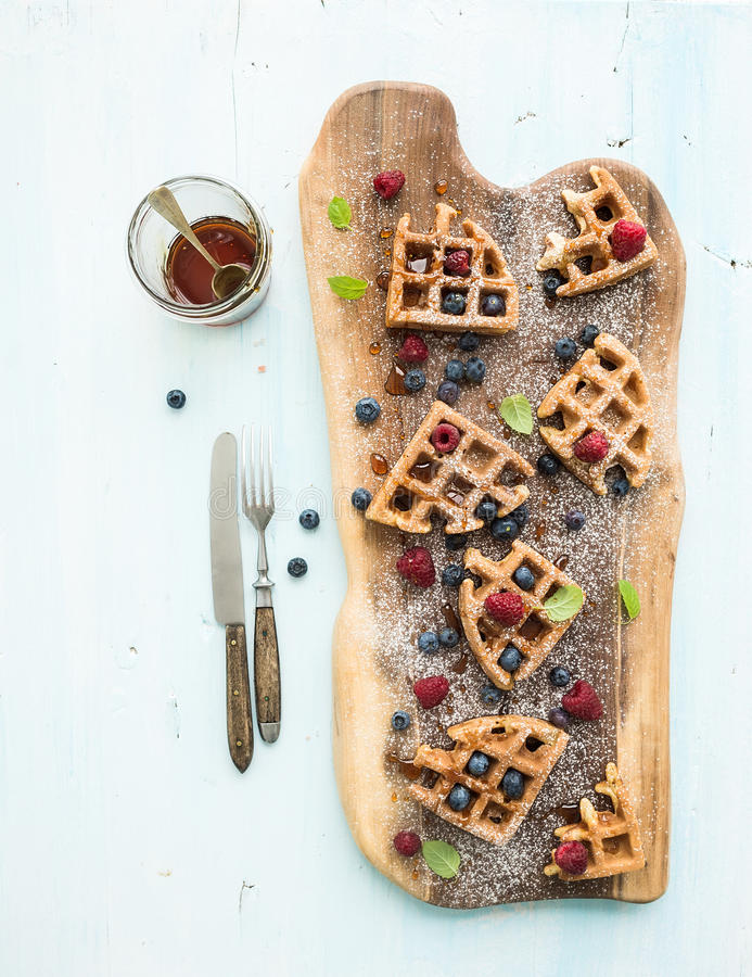 Soft Belgian waffles with berries, honey and mint royalty free stock image
