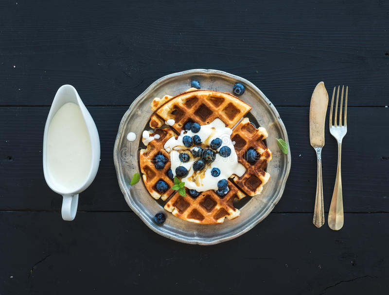 Soft Belgian waffles with blueberries, honey and stock images