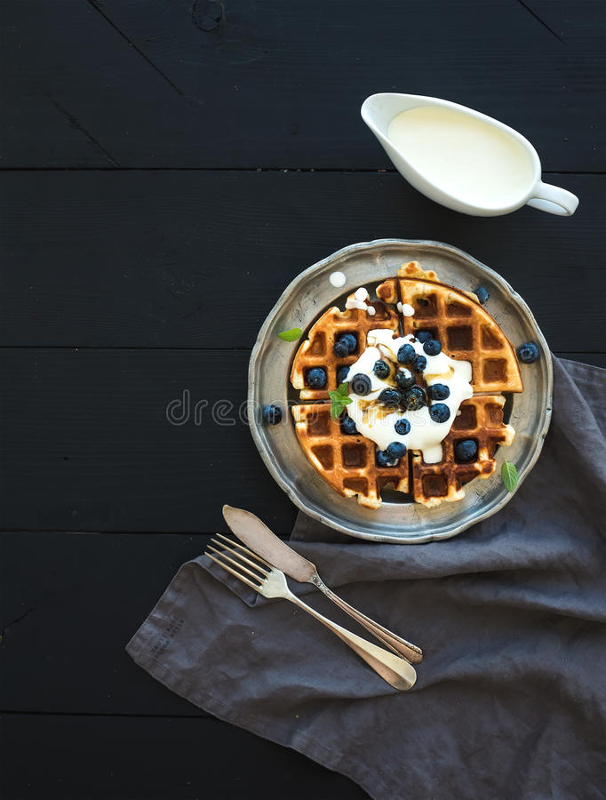 Soft Belgian waffles with blueberries, honey and royalty free stock photo