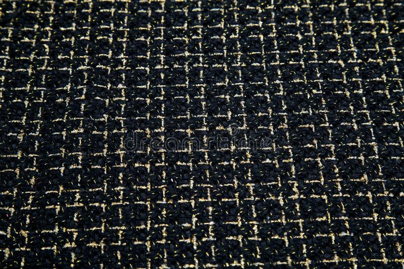 Soft black fabric with a sequin plaid. Texture stock images