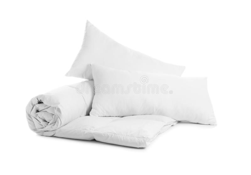 Soft blanket and pillows on white background. Soft blanket and pillows isolated on white background royalty free stock photo