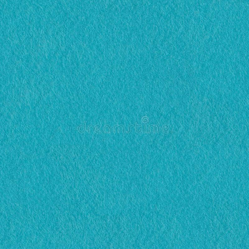 Soft blue colored felt texture.  Seamless square background, tile ready. High resolution photo stock image