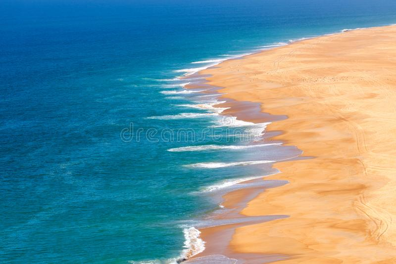 Soft blue ocean wave on sandy beach. Background. Water, sea, summer, coast, nature, tropical, surf, texture, shore, seaside, bay, hot, seascape, sunlight royalty free stock photography