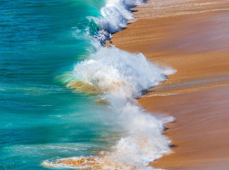 Soft blue ocean wave on sandy beach. Background stock image