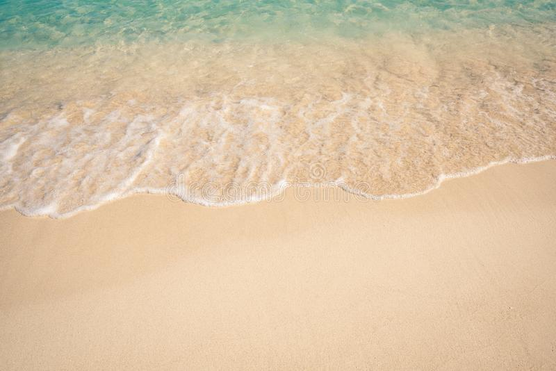 Soft Blue Ocean Wave On Sandy Beach stock photos