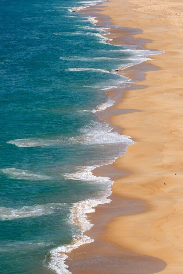 Soft blue ocean wave on sandy beach. Background.  stock photos