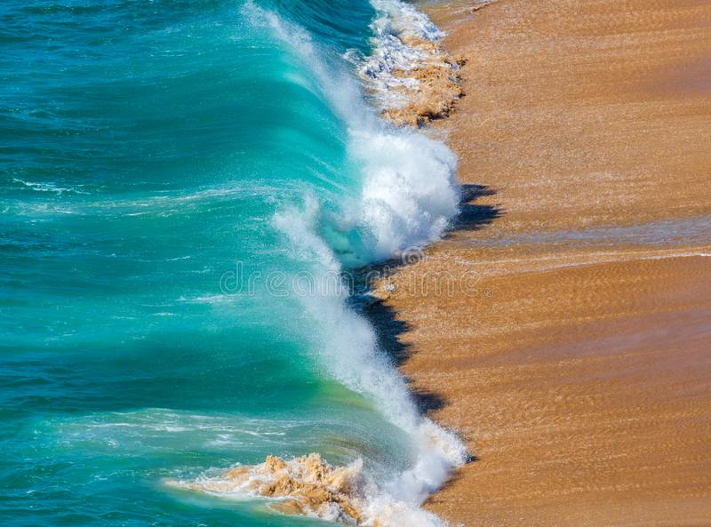 Soft blue ocean wave on sandy beach. Background.  royalty free stock image