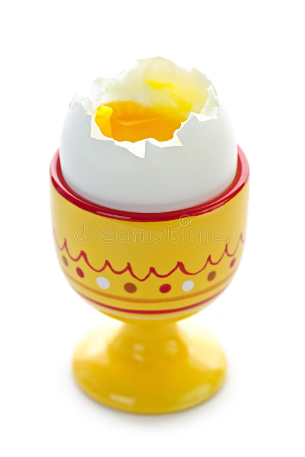 Soft boiled egg in cup stock photo