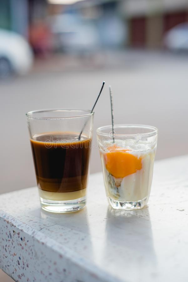 Soft boiled egg in glass, hot coffee in glass ,Thai coffee, Viet. Nam coffee, Vietnam food, Thai food stock photo