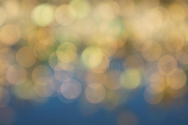 Soft bokeh background. Beautiful natural bokeh blur background in soft golds and blues stock images