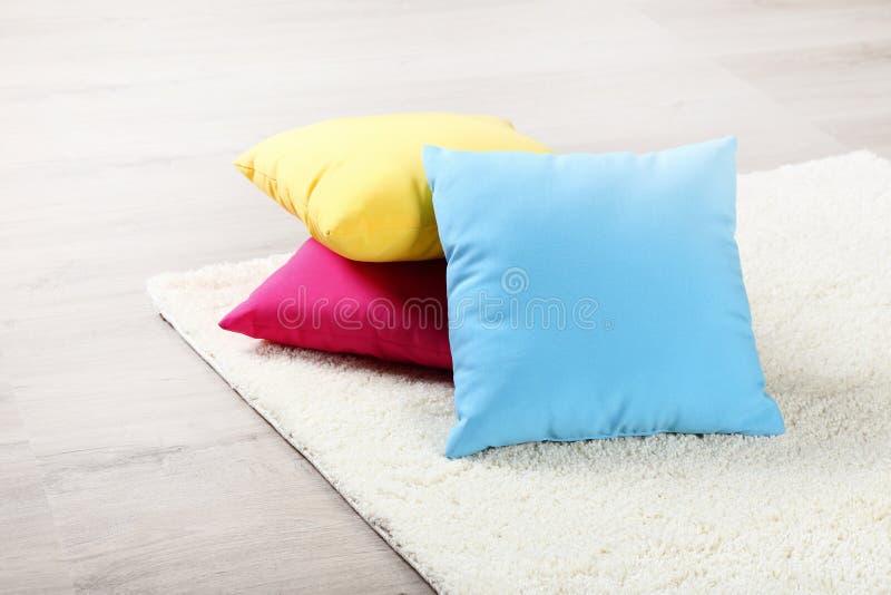 Carpet with colorful pillows stock photos