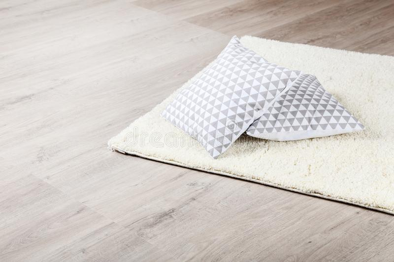 Soft carpet with pillows royalty free stock image