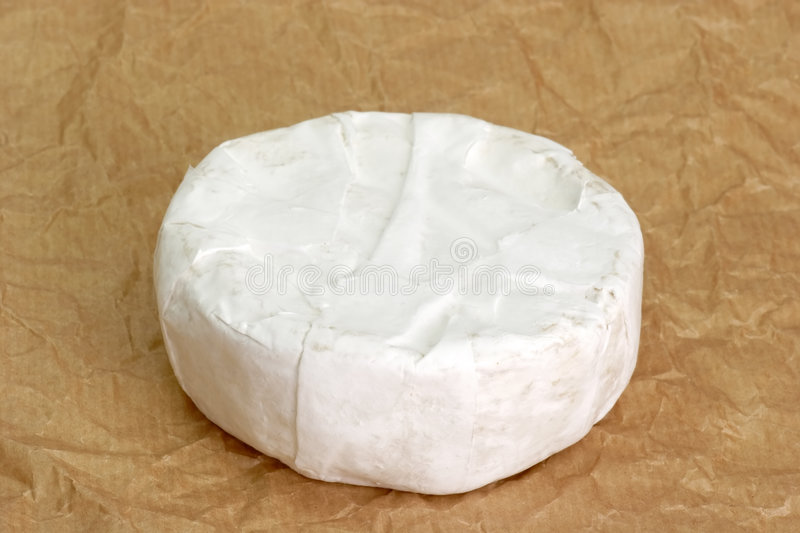 Soft cheese. Camenbert on brown paper background stock image
