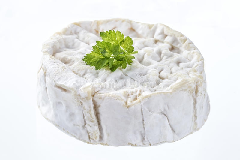 Soft cheese camenbert. Whole round of traditional camenbert cheese from Normandy stock photo