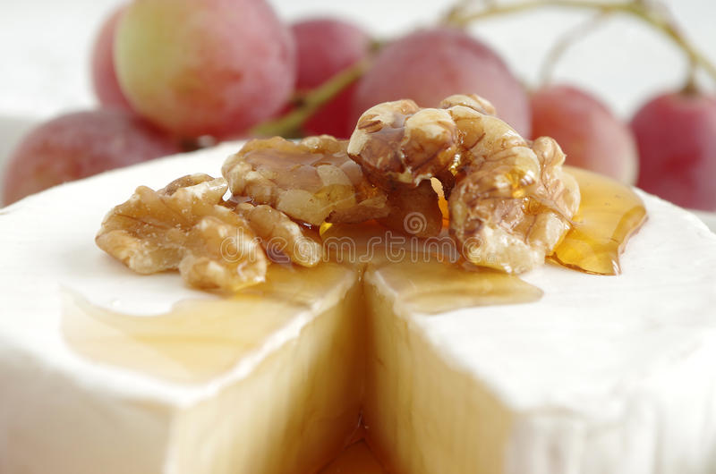 Soft cheese. French soft cheese with grapes royalty free stock images