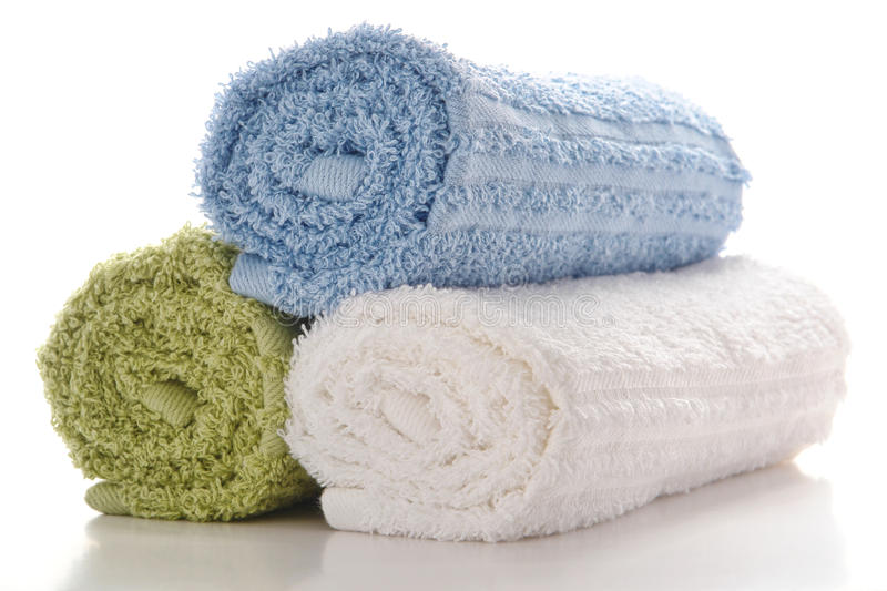 Soft and Clean Rolled Cotton Bath Towels on White royalty free stock photos