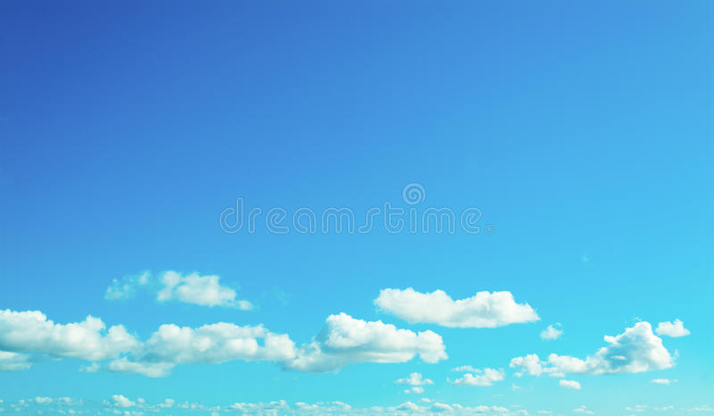 Soft clouds in the blue sky. Blue sky with white, soft clouds stock photography