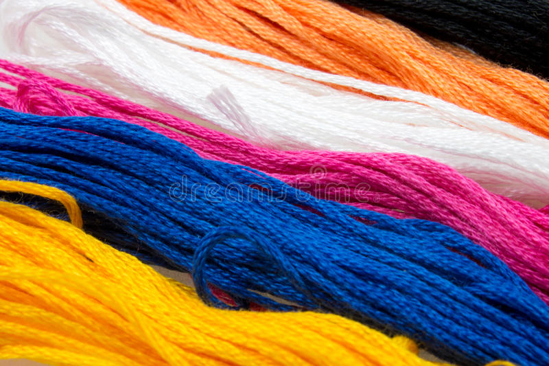 Soft colored cotton. Close-up of several strands of soft colored cotton royalty free stock photo