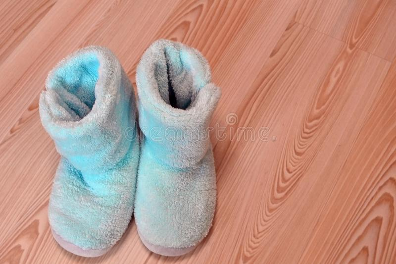 Soft comfortable home slipper. Winter cooling, warming, cold house concept.  stock images