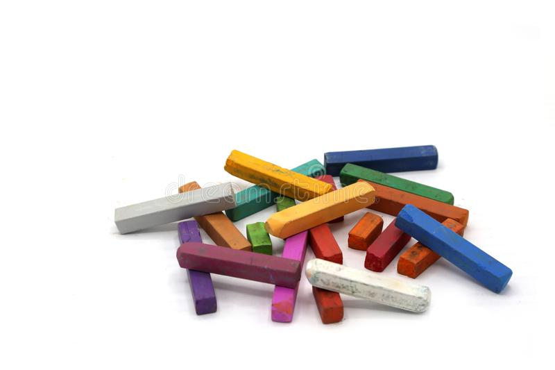Soft crayons, chalk pastels isolated on white background. Pile of bright color pastel stock image