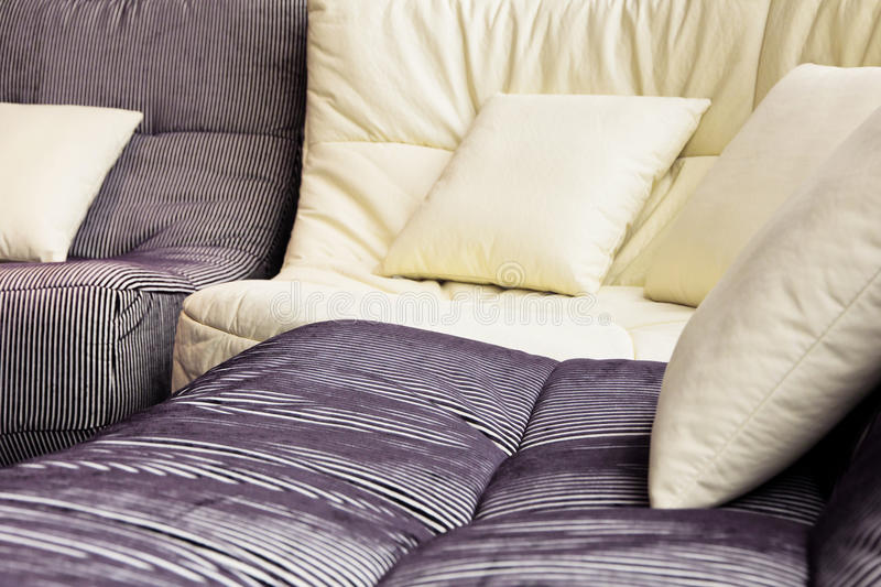 Soft cushion in sofa stock images