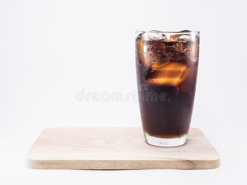 Soft drink is cool with ice cubes in full glass stock image