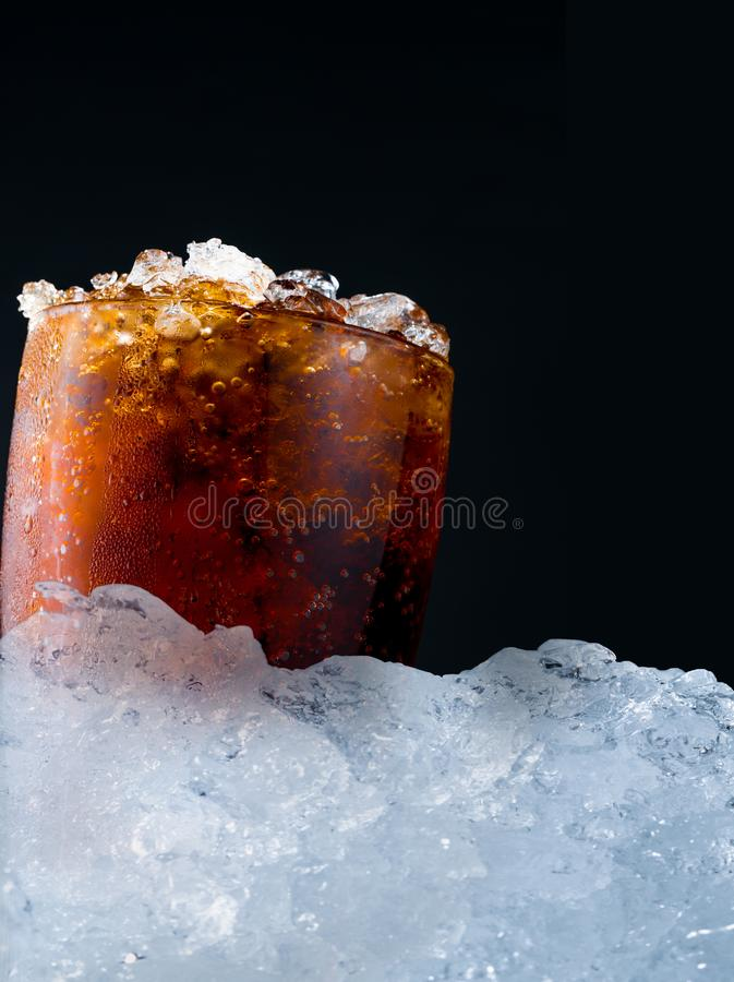 Soft drink with crushed ice cubes in glass put on pile of ice cu royalty free stock photography